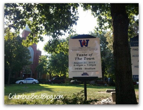 a sign on Worthington Village Green for Taste of the Town event